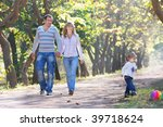 happy family walking in park   Shutterstock . vector #39718624