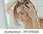 nervous girl looking in the... | Shutterstock . vector #397195030