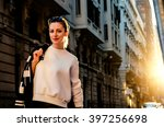 young stylish woman stands at... | Shutterstock . vector #397256698