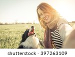 smiling lady taking selfie with ... | Shutterstock . vector #397263109