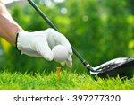 Golfer's Hand Holding Golf Bal...