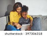 mom and daughter with tablet... | Shutterstock . vector #397306318