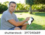 young man relaxing with a... | Shutterstock . vector #397340689