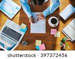 businesswoman working on a... | Shutterstock . vector #397372456
