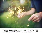 child holding sparklers   Shutterstock . vector #397377520