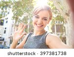 beautiful young joyful tourist... | Shutterstock . vector #397381738
