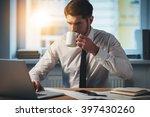 sip of fresh coffee at work....   Shutterstock . vector #397430260