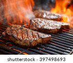 grilling steaks on flaming... | Shutterstock . vector #397498693