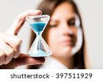 hourglass with a light blue... | Shutterstock . vector #397511929
