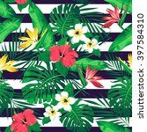 tropical flowers and leaves on... | Shutterstock .eps vector #397584310