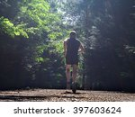 Athletic Man Running In Forest...