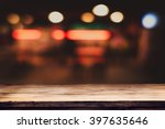 Stock photo empty top of wooden table or counter on cafeteria bar coffeeshop background for product display 397635646