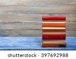 stack of hardback books on... | Shutterstock . vector #397692988
