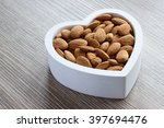 heart filled with almonds | Shutterstock . vector #397694476