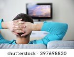 young handsome man watching tv... | Shutterstock . vector #397698820