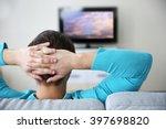 young handsome man watching tv... | Shutterstock . vector #397698820