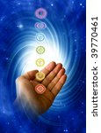 healing energy of chakra with male hand and mystical whirl - stock photo