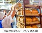 factory worker puts bread on... | Shutterstock . vector #397715650