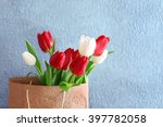 Red And White Tulips In Paper...