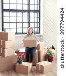 cute girl during moving home   Shutterstock . vector #397794424