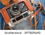 retro camera on jeans | Shutterstock . vector #397809640
