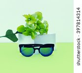Small photo of Fresh Mix. Fashionable Sunglasses and Flowers. Green Accent.