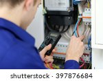 young electrician measuring... | Shutterstock . vector #397876684