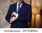 gentlemans hands with cufflinks | Shutterstock . vector #397938964