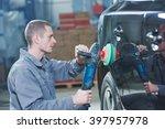 auto mechanic buffing car...   Shutterstock . vector #397957978