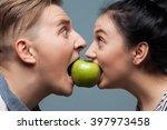 man and woman eating an apple | Shutterstock . vector #397973458