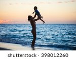 mother and son having fun on... | Shutterstock . vector #398012260
