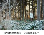 Man Standing In Forest With...