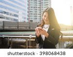 working woman writing note... | Shutterstock . vector #398068438
