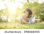 young girl listening to music... | Shutterstock . vector #398068450