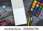 Empty Sketchbook On Chalk Boar...
