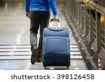 young man pulling suitcase in... | Shutterstock . vector #398126458