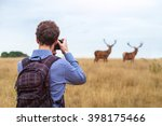 photographer taking photo of...   Shutterstock . vector #398175466