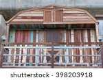 Small photo of Terraced of wooden houses in urban Cowboy