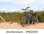 bicycle standing in the dunes | Shutterstock . vector #3982045