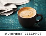 coffee mug with newspaper on... | Shutterstock . vector #398234479