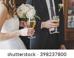 couple holding glasses in their ...   Shutterstock . vector #398237800