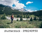 gilr hiking into into canadian... | Shutterstock . vector #398240950