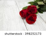 Beautiful Red Roses On A White...