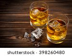 two glasses with ice and... | Shutterstock . vector #398260480