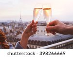 two glasses of champagne or... | Shutterstock . vector #398266669