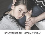 a sad daughter hugging his... | Shutterstock . vector #398274460