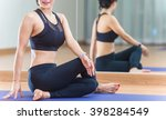 young people do yoga indoors in ... | Shutterstock . vector #398284549