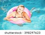 beautiful young woman enjoying... | Shutterstock . vector #398297623