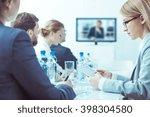 elegant men and women sitting... | Shutterstock . vector #398304580