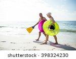 happy senior couple walking on...   Shutterstock . vector #398324230